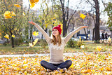 Happy woman with colorful leaves