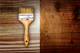 Renovation brush on wooden background