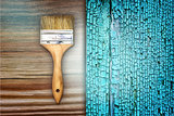 Renovation brush on wooden blue cracked texture