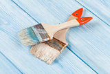 Paintbrush over blue wood