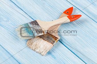 Paintbrush over blue wood
