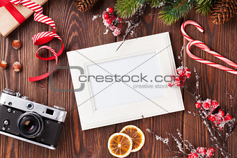 Blank photo with christmas gift, pine tree and camera