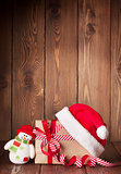Christmas gift box with santa hat and snowman