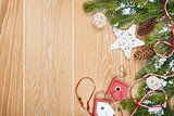 Christmas wooden background with snow fir tree and decor