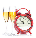 Two champagne glasses and christmas clock