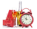 Champagne, christmas gift and alarm clock