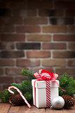 Christmas gift box and fir tree branch