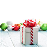Christmas gift box and colorful baubles decor