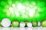 Christmas background with baubles and bokeh