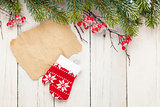 Christmas wooden background with fir tree and mitten decor