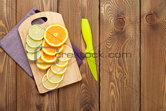Sliced citruses on cutting board