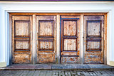 Row of four wooden doors