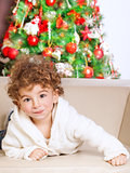 Little boy near Christmas tree