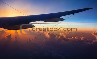 Airplane silhouette on sunset