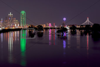 Skyline of Dallas, Texas at Night across Flooded Trinity River