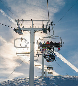 Ski chairlift going over a mountain