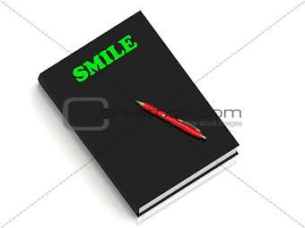 SMILE- inscription of green letters on black book
