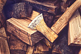Hatchet Ax and Splitted Wood Logs