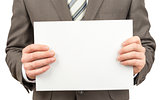 Businessman holding blank paper in hands