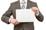 Businessman holding blank paper on white