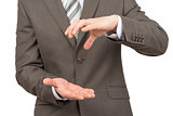 Businessman with empty place between hands