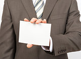 Businessman holding empty sheet of paper
