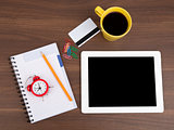 Blank copybook with tablet and alarm clock