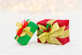Red and green Christmas gift box with shiny golden ribbon