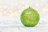 Green Christmas ball with metallic beads