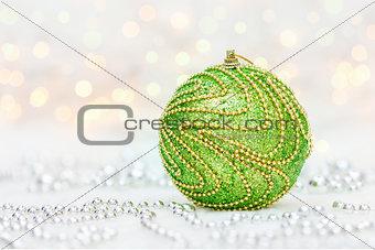 Green Christmas ball with metallic beads