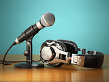 Microphone and headphones. Audio recording or radio commentator