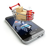 Online shopping concept. Mobile phone or smartphone with cart an