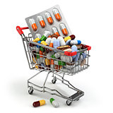 Pharmacy medicine concept. Shopping cart with pills and capsules