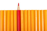 Red sharpened pencil among non sharpened yellow