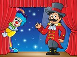 Stage with ringmaster and lurking clown
