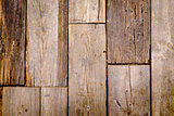 Close-up view of textured and weathered wooden tiles