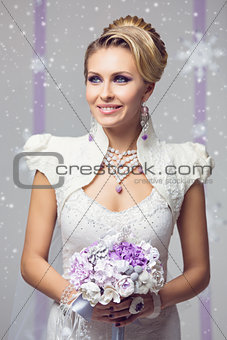 Beautiful winter bride in warm dress with flowers