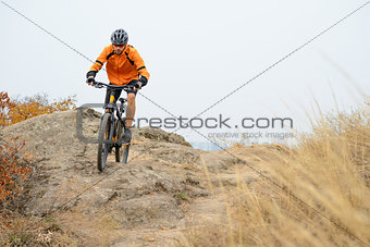 Cyclist Riding Bike on the Beautiful Autumn Mountain Trail