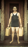 Gentleman Dressed in 1920's Era Swimsuit Holding Suitcases on