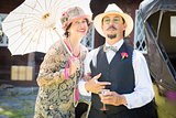 Mixed-Race Couple Dressed in 1920's Era Fashion Sipping Champa