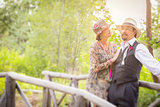1920s Dressed Romantic Couple on Wooden Bridge