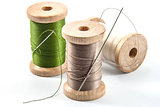 Isolated wooden spools of thread