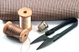 Thimble, needle, spools and scissor with cloth for hand sewing work