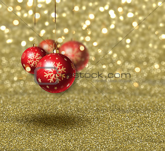 Christmas baubles on gold glitter background