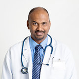 Mature Indian doctor smiling