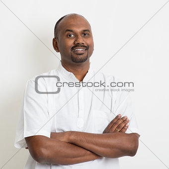 Mature casual business Indian man arms crossed