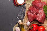 Raw fillet beef steak and spices on stone board