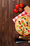 Italian pizza with cheese, tomatoes, olives and basil