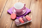 Colorful macaron cookies and coffee cup