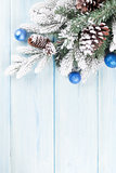 Christmas wooden background with fir tree and decor